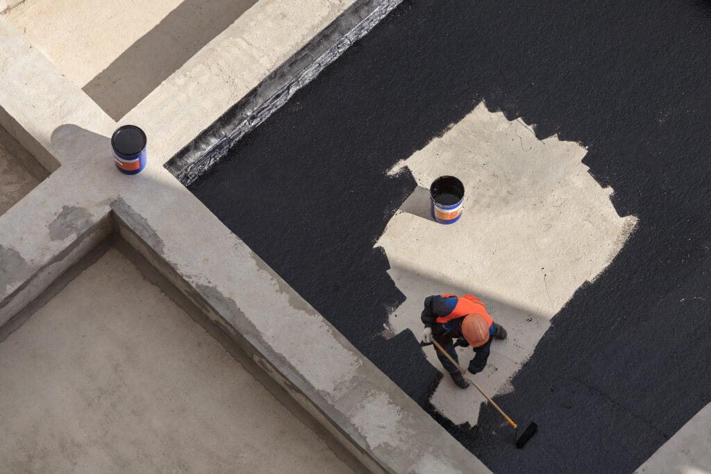 Worker waterproofing plaza deck